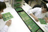 Printed Circuit Board Assembly Work Photographic Print by Ria Novosti