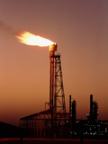 Gas Flare In Front of An Oil Refinery Premium Photographic Print by David Parker