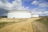 Oil Refinery Storage Tanks Photographic Print by Paul Rapson