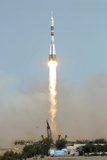 Launch of Soyuz TMA-15 Mission Posters by Ria Novosti
