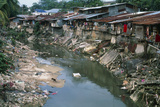 Polluted River Running Through a Malaysian Slum Photographic Print by David Nunuk