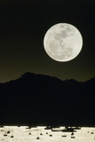 Full Moon Seen From Earth Over Mountains Photographic Print by David Nunuk