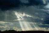 Sun's Rays Breaking Through Clouds. Photographic Print by Pekka Parviainen