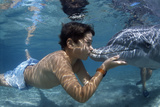 Boy Kissing Dolphin Photo by Alexis Rosenfeld