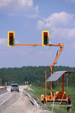 Solar-powered Traffic Lights Photographic Print by Alan Sirulnikoff