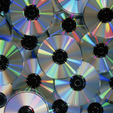 Compact Discs with Light Interference Patterns Photographic Print by Damien Lovegrove