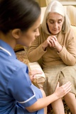 Nurse on a Home Visit Prints by Science Photo Library