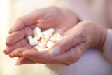 Handful of Pills Photo by Science Photo Library