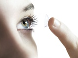 Contact Lens Use Photographic Print by Science Photo Library