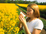 Young Woman Suffering From Hay Fever In a Field Photographic Print by Damien Lovegrove
