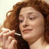 Woman Holds a Nicorette Nicotine Drug Inhaler Photographic Print by Damien Lovegrove