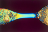 PLM of Two Synthetic Liquid Crystal Polymer Fibres Photographic Print by Science Photo Library
