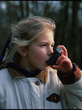 Girl Using Inhaler Photographic Print by Damien Lovegrove