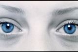Close-up of Woman's Face Showing Her Two Blue Eyes Photographic Print by Damien Lovegrove