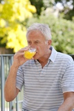 Diabetic Man Drinking a Glucose Drink Photographic Print by Science Photo Library