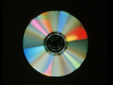 Compact Disc with Light Interference Patterns Photographic Print by Damien Lovegrove