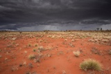 Storm Clouds Over Desert Photographic Print by Robbie Shone