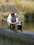 Measuring Water Levels Photographic Print by Paul Rapson