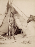 A Native American Stands at the Entrance to His Teepee Holding a Rifle, 1880-90 Photographic Print by William Notman