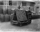 Woman Driving an Electric Truck Carrying Shells in the Citroen Factories, C.1916 Photographic Print by Jacques Moreau