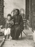 Arab Kawass (Ottoman Guard) with a Young Boy in the Garden of a House in the Judea District of… Photographic Print by Corporal Henry Phillips