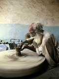 Old Man Working on a Potter's Wheel, Thatta, Pakistan Photographic Print