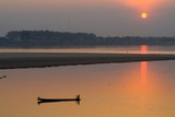 Silhouetted Man in Longtail Boat Along the Mekong River Photographic Print
