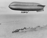 Rnas Coastal Class Airship C23A Flying Above a Warship Convoy, C.1917 Photographic Print by  Thomas E. Grant and Horace Grant