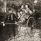 Runner Pulling Two Geishas on a Rickshaw in Japan, C.1900 Photographic Print