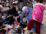 Child Trying on Shoes, Kabul Photographic Print