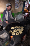 A Man Cooking Jalabi Sweet Snack in a Market, Kabul Photographic Print