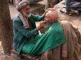 A Street Barber in Kabul Shaving a Man for the Hajj Pilgrimage Photographic Print