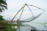 Fishermen Operating Chinese Fishing Nets of Kochi Photographic Print