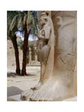 A Princess, Perhaps Bentanta, Standing at the Feet of a Colossal Statue of Her Father Ramesses II Giclee Print