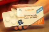 Metronidazole Antibiotic Pills Photographic Print by Tim Vernon