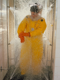 Pharmaceutical Worker In Isolation Suit Shower Photographic Print by Geoff Tompkinson