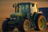 Time-exposure Image of a Tractor At Work Photographic Print by Jeremy Walker