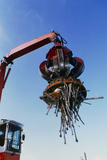 Large Electromagnet In Use At a Scrapyard Photographic Print by Jeremy Walker