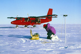 Researcher Measures the Flow Rate of a Glacier Posters by David Vaughan
