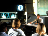 Doctor Giving a Lecture To Medical Students Posters by Geoff Tompkinson