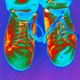 Thermogram of Feet Wearing Trainers Photographic Print by Dr. Arthur Tucker
