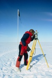 Glaciologist Using Theodolite on Ronne Ice Shelf Photographic Print by David Vaughan