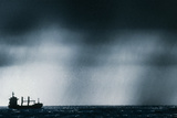 Ship At Sea Caught In Stormy Weather Photographic Print by Geoff Tompkinson