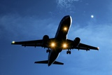 Airbus A320 Airliner Landing At Night Posters by Detlev Van Ravenswaay