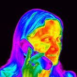 Woman Using a Mobile Phone, Thermogram Photographic Print by Dr. Arthur Tucker