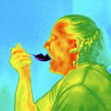 Thermogram of a Woman Eating Ice Cream Photographic Print by Dr. Arthur Tucker