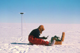 Researcher Measures the Flow Rate of a Glacier Photographic Print by David Vaughan