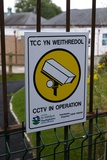 Security Camera Sign At a School In Wales Photographic Print by Mark Williamson