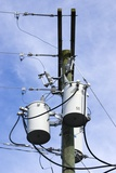 Electricity Pole with Transformers Photographic Print by Mark Williamson