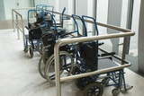 Wheelchairs At Airport Prints by Mark Williamson